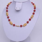 collier précolombien Fossile rouge
