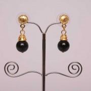 Boucles d'oreilles ethniques artisanales de Colombie composées de pierres d'onyx noir et de plaqué or